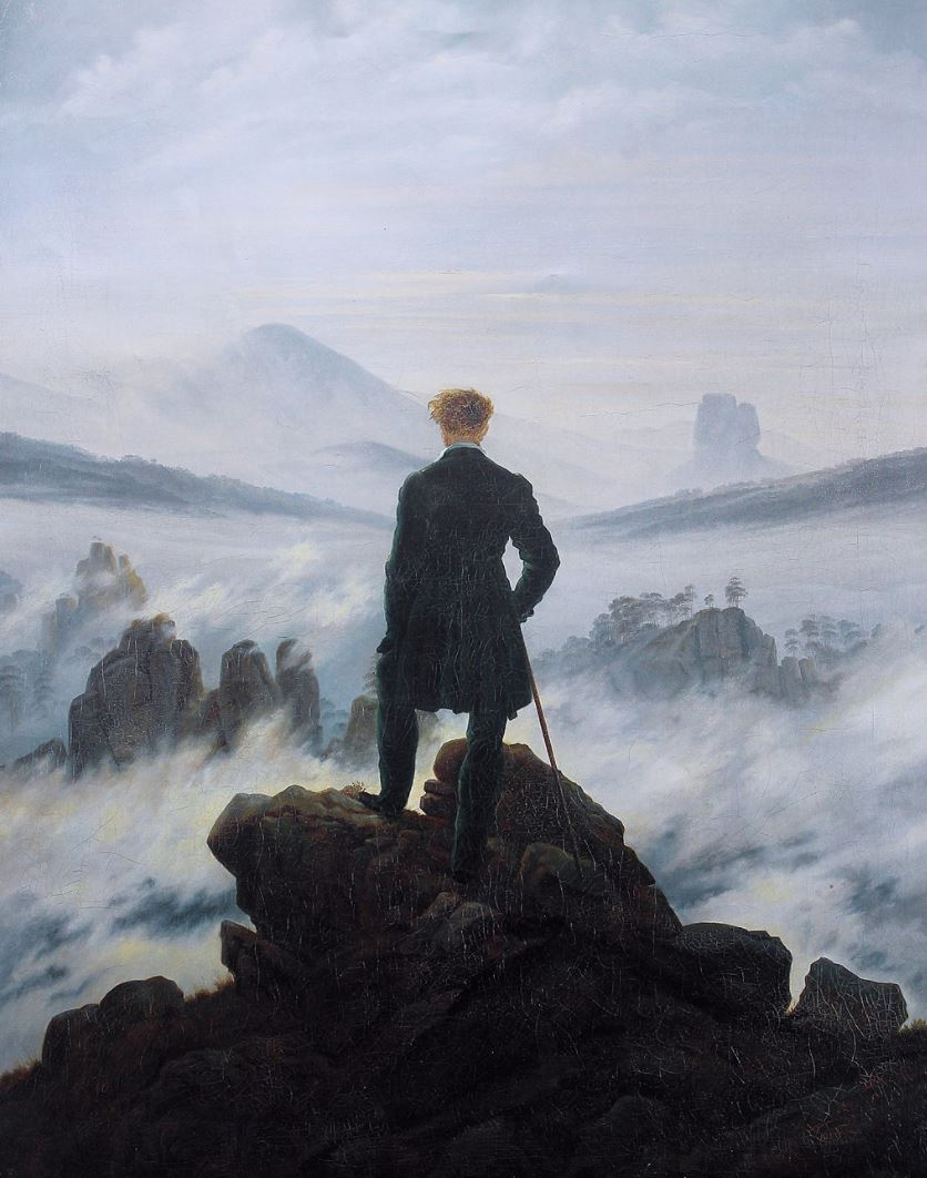 A person standing on a rock Description automatically generated with medium confidence